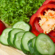 Pepper, salad and cucumber on a board close up. — Stock Photo #3308612