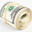 10 thousand US dollars rolled up — Stockfoto