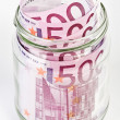 Stock Photo: 500 Euro bank notes in glass jar