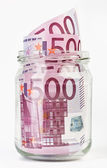500 Euro bank notes in a glass jar — Stock Photo