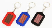 Three small trinket LED torch — Stock Photo