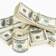 Many bundle and roll of US 100 dollars — Stock Photo #3213876