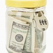 Many 100 US dollars in a glass jar — Stock Photo #3213889
