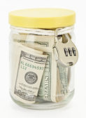 Many 100 US dollars in a glass jar — Stock Photo