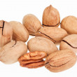 Many pecan nuts isolated on white, one cracked — Stock Photo