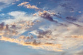 Cumulus clouds on sunset sky background — Zdjęcie stockowe