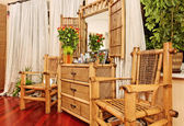 Wooden ethnic bamboo boudoir furniture — Stock Photo