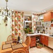 Kitchen interior with wooden furniture and many utensils — Stock Photo