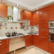 Kitchen interior with wooden furniture and build in utensils - Foto Stock