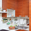 Part of Kitchen interior with wooden furniture and sink — Stock Photo