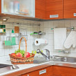 Part of Kitchen interior with wooden furniture and sink — Stock Photo #3543318