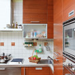 Part of Kitchen interior with wooden furniture and build in micr — Stock Photo