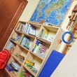 Stock Photo: Part of nursery room interior with wooden shelving