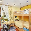 Nursery room interior with two-high wooden bed - Stock Photo