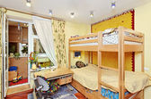 Nursery room interior with two-high wooden bed — Stock Photo