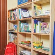 Part of nursery room interior with wooden shelving — Stock Photo