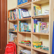 Part of nursery room interior with wooden shelving - Stock Photo