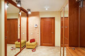 Elegance anteroom interior in warm tones with hallstand — Stock Photo