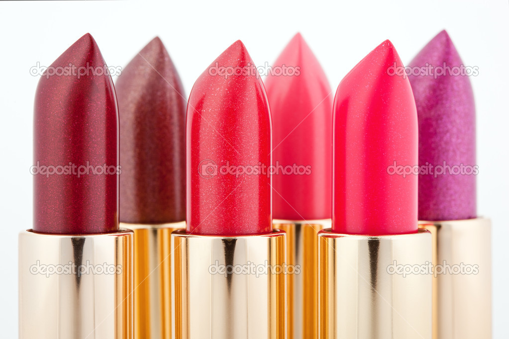 Multicolored color lipsticks arranged in two lines isolated on white, shallow depth of field — Stock Photo #3609755