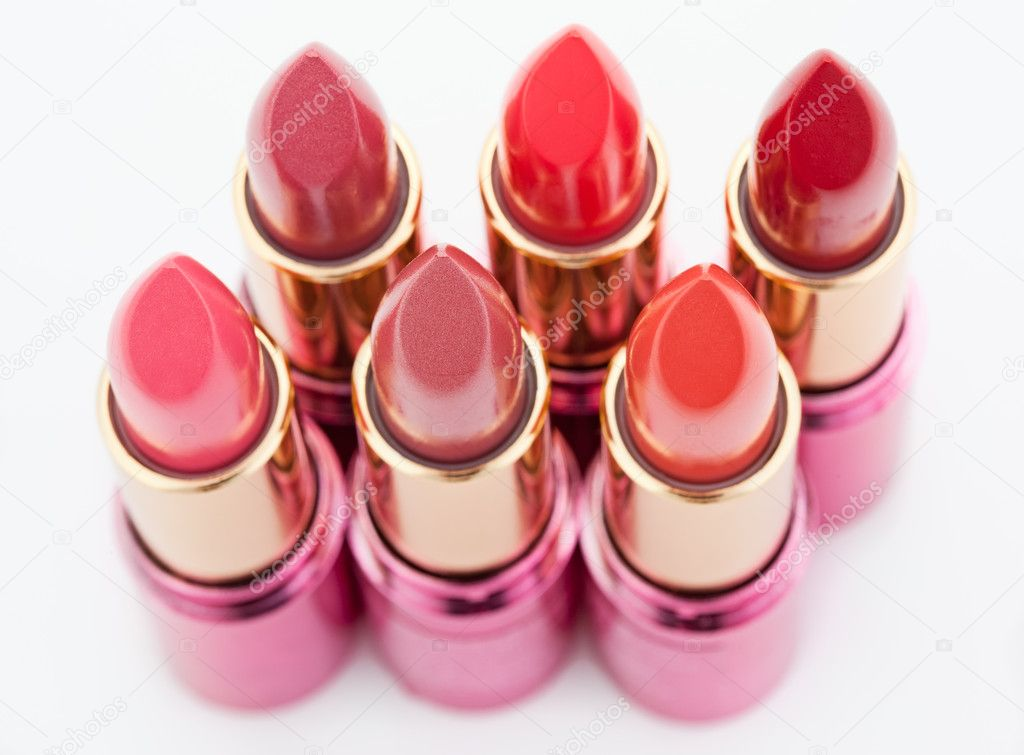 Multicolored color lipsticks arranged in two lines isolated on white, top view, shallow depth of field — Stock Photo #3609801