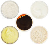 Set of 5 different dermal masks and scrubs — Stock Photo