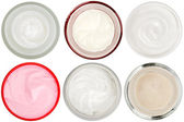 Set of 6 different dermal creams and gels isolated — Stock Photo