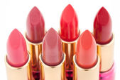 Multicolored color lipsticks arranged in two lines — Stock Photo