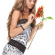 Young beautiful girl with long hairs holding sunflower on white - Stockfoto