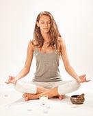 Young beautiful woman meditating in lotus pose — Stock Photo