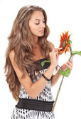 Young beautiful girl with long hairs holding sunflower on white — Stock Photo