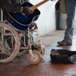 Beggar on wheelchair — Stock Photo