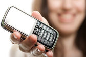 Mobile phone in women hand — Stock Photo