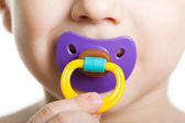 Child with baby pacifier — Stock Photo