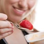 Eating yogurt — Stock Photo