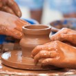 Clay potter hand - Stock Photo