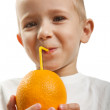 Drinking orange fruit — Stock Photo