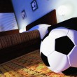 Soccer ball in a bedroom — Stock Photo