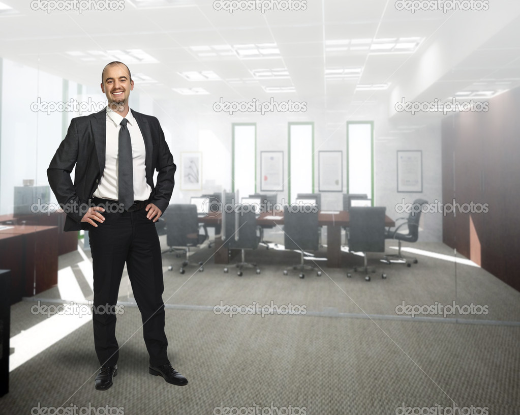 Young smiling businessman standing 3d  in office — Stok fotoğraf #2861739