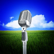 Vintage microphone and nature — Stock Photo