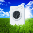 Washing machine and green  field - Stock Photo
