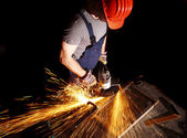 Manual worker with grinder — Stock Photo