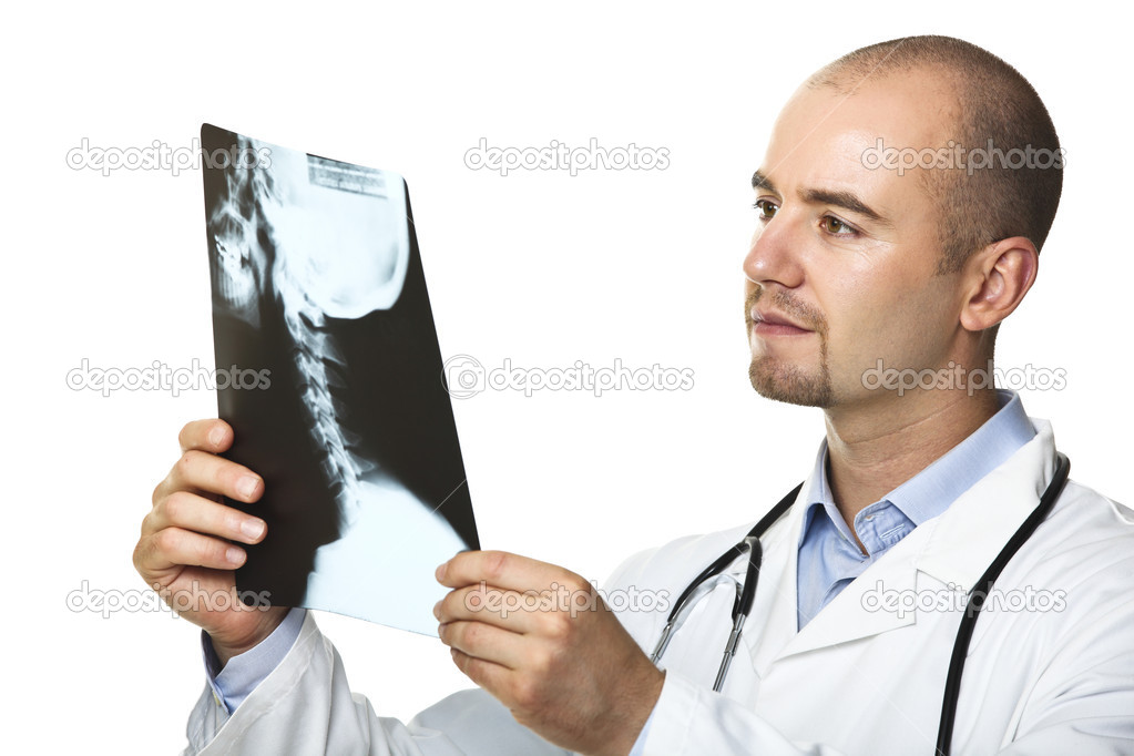 Young caucasian doctor and xray isolated on white — Stock Photo #3518539