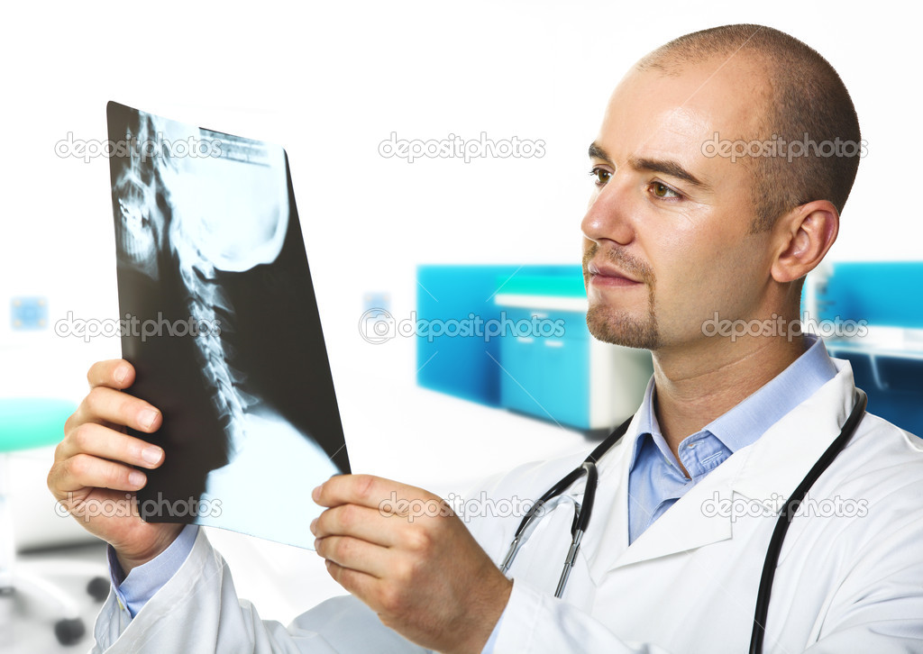Young doctor with xray and hospital indoor background — Stock fotografie #3518595