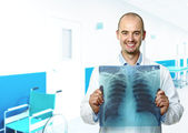 Smiling doctor with xray — Stock Photo