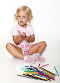 Little girl play with pen — Stock Photo