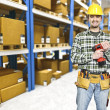 Handyman in warehouse — Stock Photo