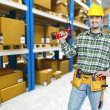 Warehouse and handyman — Stock Photo