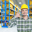 Smiling worker in warehouse — Stock Photo
