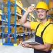 Foto Stock: Smiling worker in warehouse