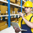 Worker in warehouse - Stock Photo